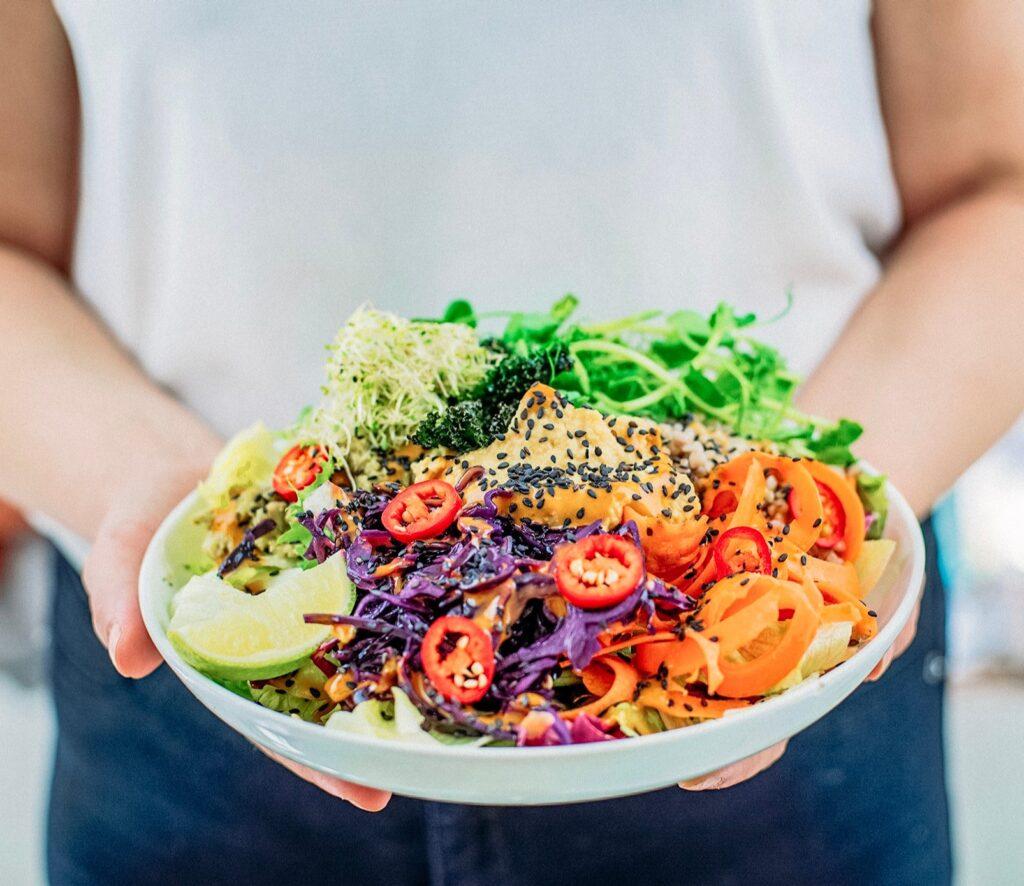 Vegan diet includes fruit, vegetables, grains, legumes, nuts, vegan cheese, salami, yoghurt and burgers